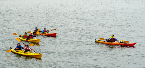Kayakers go for a paddle, despite the chilly weather.