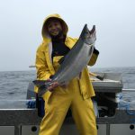 Jeremy holding up a beautiful Coho Salmon