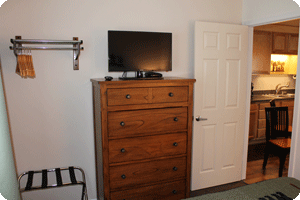 Dresser and TV stand in one bedroom of the Wild Strawberry Suites in Sitka Alaska
