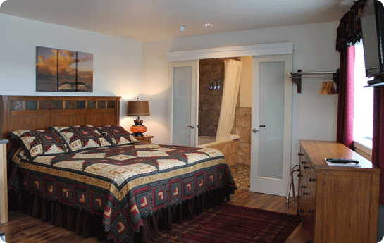 King Bed in Room 11 in our Wild Strawberry Suites