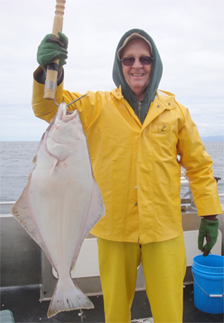 05 20 2009 Bill and his Pacific Halibut caught off the West Coast of Kruzof Island