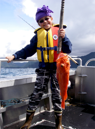 06 20 2009 Karina holding a yellow eye rockfish because a sea lion got hold of the king salmon