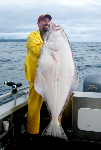 06 28 2009 It takes a strong man to lift such a mighty halibut